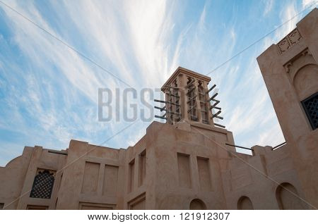Arabian old style architecture with wind tower.