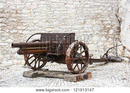 antique field artillery gun with reinforced wheel