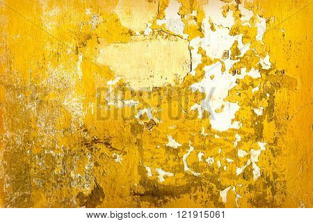 Yellow concrete cracked wall texture