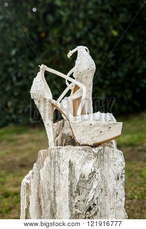 bride shoes on a rock and agarden background