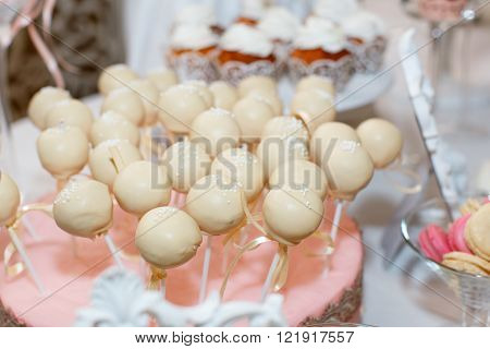 white delicacies cakes balls on the holiday table