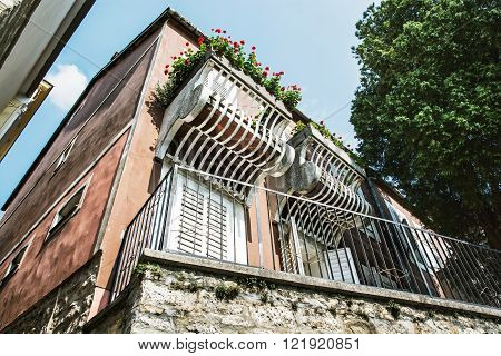 Old house with balcony and flowers. Architectural theme. European style.