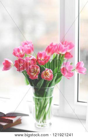 Fresh bouquet of tulips on a windowsill