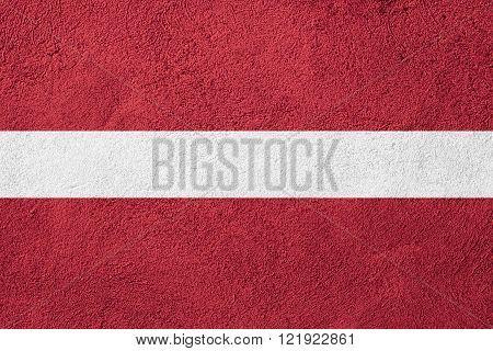 flag of Latvia or Latvian banner on stone background