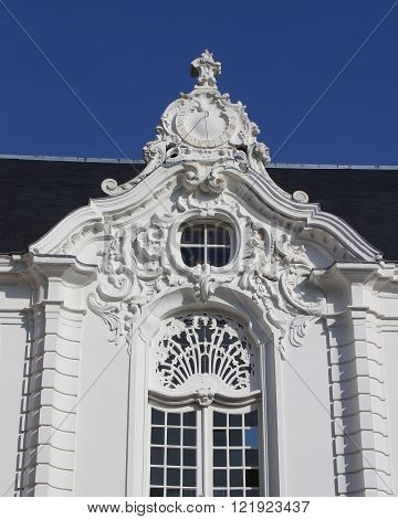 A very ornate exterior wall and clock (Rococo style) of the old Town Hall in Aalst, East Flanders, Belgium .