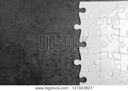 White jigsaw puzzle on grey background