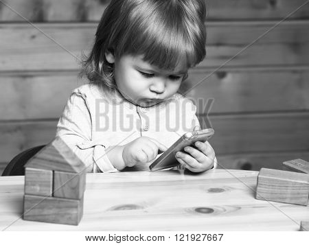 Small Boy With Computer And Phone