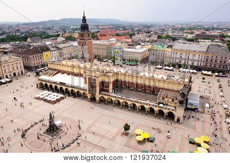 KRAKOW POLAND - JULY 2 2009: Adam Mickiewicz monument Cloth Hall and Town Hall Tower at the Grand Square (aka Main Market square) viewed from St. Mary Cathedral tower