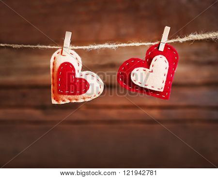 Valentine concept. Two love hearts hanging on clothesline