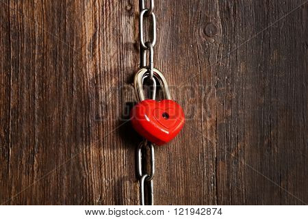 Valentine concept. Love heart hanging on chain