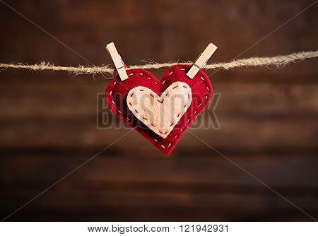 Valentine concept. Love heart hanging on clothesline