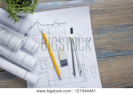 Architect worplace top view. Architectural project, blueprints, blueprint rolls and  divider compass