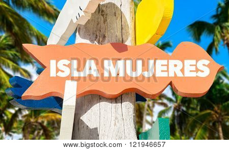 Isla Mujeres signpost with palm trees