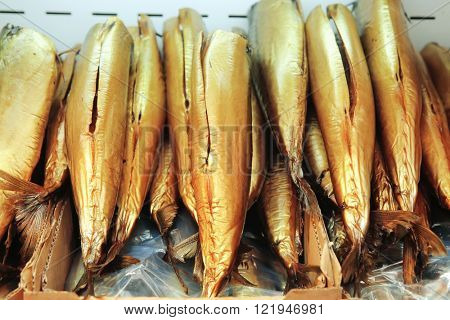 smocked Norwegian fish mackerel on plate on market