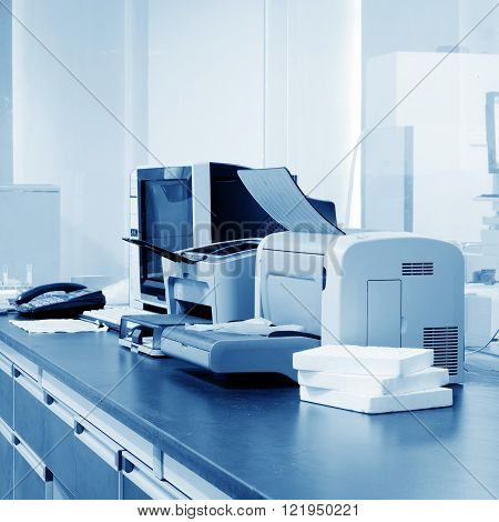 Modern Office PC printers and copiers and other equipment.