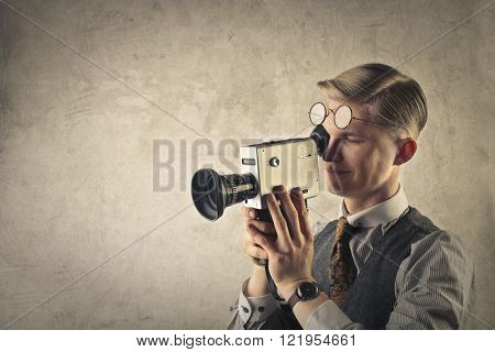 Man using an old-fashioned camera