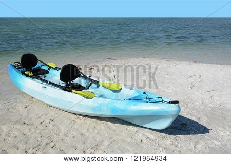 blue kayak on the beach tropical setting