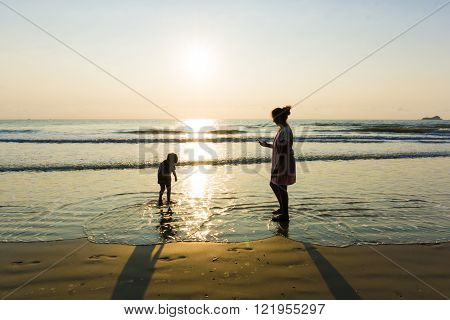 Happy Single Mom Family Silhouettes On Beach