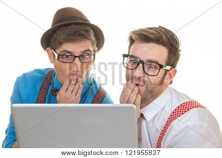 funny computer nerds looking at laptop