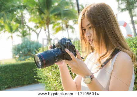 Beautiful Asian Young Woman Photographer