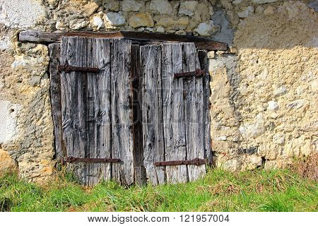 weathered, old, rustic barn door of a bulding
