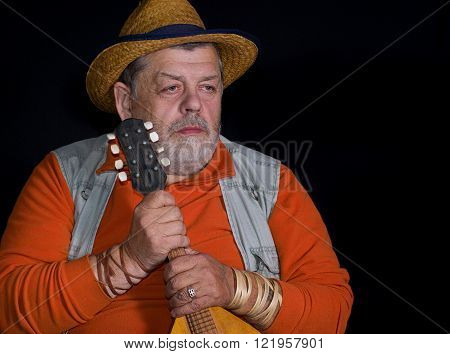 Nice portrait of of a senior musician with mandolin in contemplation