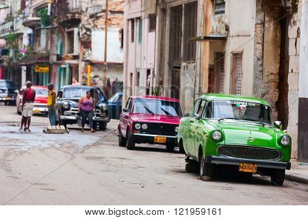 HAVANA, CUBA - JULY 17, 2013: Old vintage, classic retro Chevrolet cars are on the street of Old Havana, Havana, Cuba. This is the most common mode of transportation for locals and tourists.