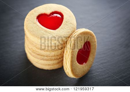 Pile of love cookies on grey stand, closeup