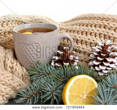 Beautiful winter composition with cup of hot drink, on white background