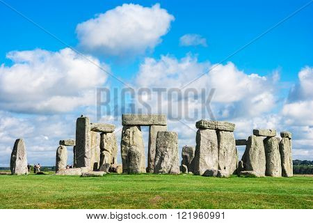 Blue sky with white fluffy clouds over the massive circle of stones that make up the world famous prehistoric landmark and World Heritage Site - Stonehenge on Salisbury Plain Wiltshire England