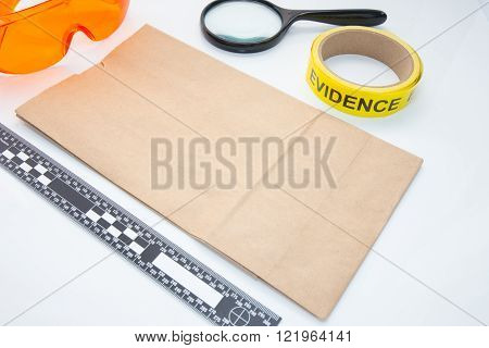 evidence bag and space for text with forensic tool for crime scene investigation