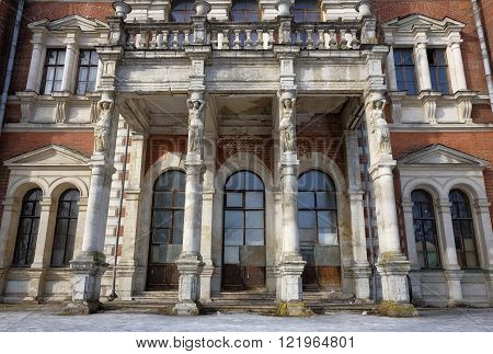 BYKOVO, RUSSIA - MARCH 9, 2016: Caryatids-columns entrance of the main house manor Bykovo 19th century