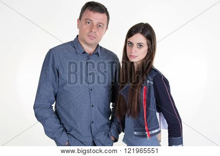 Father And Daughter Standing On White Background