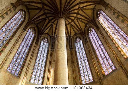 Toulouse, France - February 20, 2016: Photograph of  huge pillar and colorful windows in the Augustian convent.