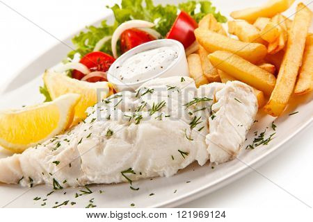 Fish dish - boiled fish fillet, chips and vegetables