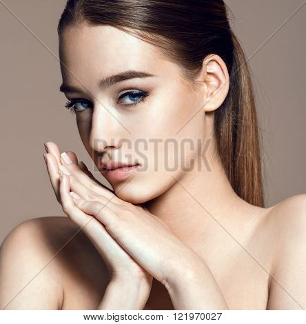 Charming young woman with perfect makeup skin care concept / photoset of attractive brunette girl on beige background