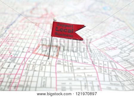 Red pin flag with Support Local Business message