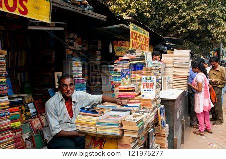 KOLKATA, INDIA - JAN 15: Adult male book seller waiting for customerson the street market on January 15, 2013 in Kolkata. From 1976 Kolkata have the Book Fair with 2 million visitors annual