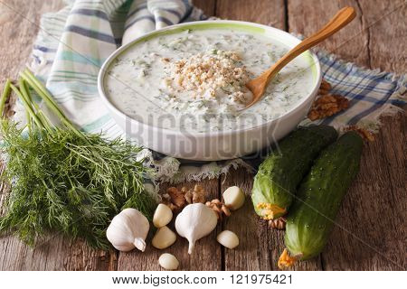 Summer Cold Soup Tarator Close Up And Ingredients On The Table. Horizontal