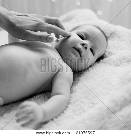 Mom Touching With Care Infant
