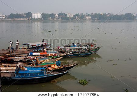KOLKATA, INDIA - JANUARY 17: River boats waiting for the passengers at the dock at the sunny day on January 17, 2013. Third biggest indian city Kolkata is home to approximately 14.1 mill.people