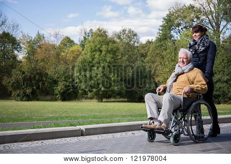 Photo of senior man spending leisure time outdoors