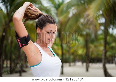 Fitness Woman Ready For Workout At Tropical Beach