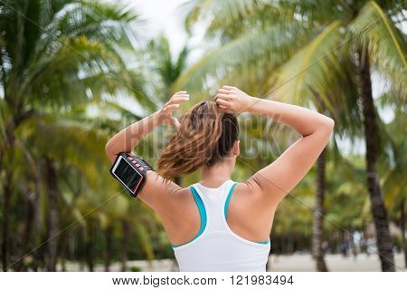 Fitness Woman Tying Ponytail For Working Out