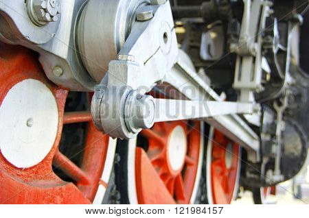 Detailed photo of a steam locomotive wheel drive for technical illustration or energetic background