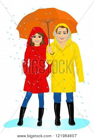 happy couple in raincoats standing with umbrella