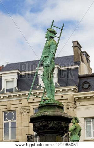 Brussels, Belgium - May 10: Monument of chimneysweep is one of the monuments along the fence of the park Sablon May 10 2015 in Brussels Belgium.