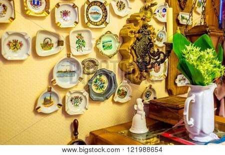 ODESSA UKRAINE - MAY 18 2015: The souvenir ashtrays from different places could be used as the decoration elements on May 18 in Odessa.