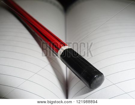 Macro Shot of Pencil Lying on Diary Page
