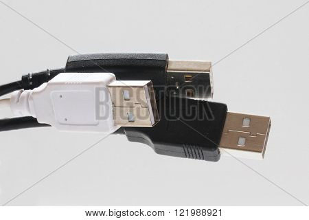 Black and white usb cables on the isolated background